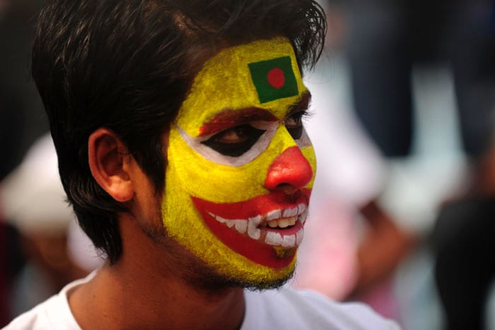 If Mink painted her, this Bangladeshi fan had his face painted in the national colours before the first match of the Cricket World Cup 2011. (AFP Photo)