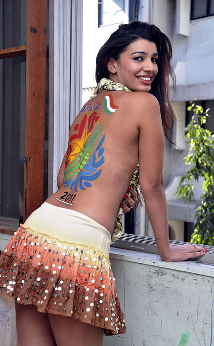 High on cricket, model-turned-actress Mink Singh decided to 'back' the ICC Cricket World Cup 2011 and the Indian team, quite literally. (AFP Photo)