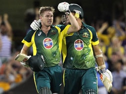 James Faulkner steals thrilling one-wicket win for Australia in Brisbane