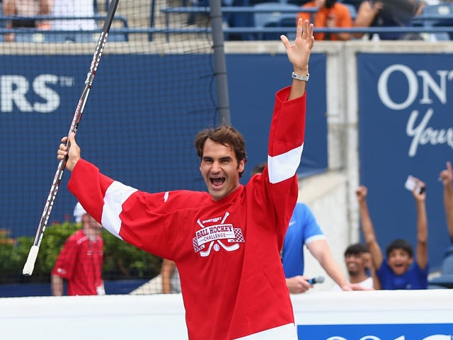 Roger Federer Has a Ball on the Hockey Rink