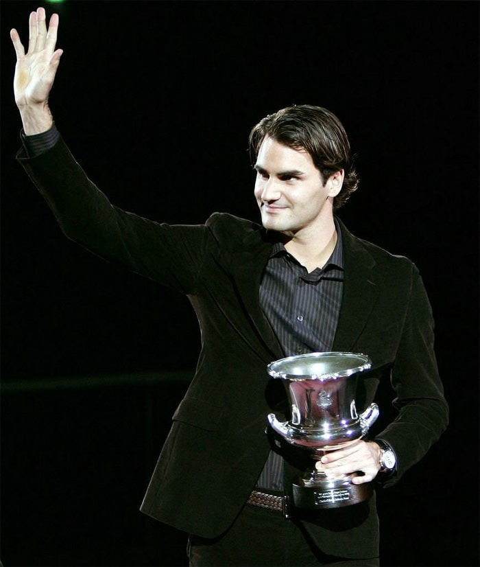 <b>2002</b>: Federer reached his first Masters Series final in 2002 at the NASDAQ-100 Open in Key Biscayne, Florida, where he lost to Andre Agassi. He won his next Masters final in Hamburg. He also won both his Davis Cup singles matches against former World No. 1 Russians Marat Safin and Yevgeny Kafelnikov. He had early-round exits at the French Open, Wimbledon, and the US Open; Federer also suffered the devastating loss of his long-time Australian coach and mentor, Peter Carter, in a car crash in August. Federer reached No. 6 in the ATP Champions Race by the end of 2002. He jumped in the rankings from 13th at the end of September to 7th by the middle of October. This qualified him for the first time in the year-ending Tennis Masters Cup. However, his run at the tournament was ended in the semi-finals by then World No. 1 and eventual champion Lleyton Hewitt. (Wikipedia)