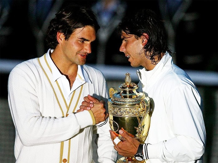"""<b>2008</b>: Federer began the year by attempting to defend his title at the Australian Open. He lost, however, in the semi-finals to eventual champion Novak Djokovic 7–5, 6–3, 7–6(5). This ended his record of ten consecutive Grand Slam finals, the most ever for a men's player. In March, Federer revealed that he had recently been diagnosed with mononucleosis and that he may have suffered from it as early as December 2007. Federer also had an illness related to food poisoning prior to the start of the Australian Open. He noted, however, that he was now """"medically cleared to compete"""".<br><br> At the French Open, Federer was dispatched quickly by Nadal, in the final 6–1, 6–3, 6–0. At Wimbledon, Federer once again played World No. 2 Nadal in the final. He eventually lost the match 6–4, 6–4, 6–7(5), 6–7(8), 9–7. The defeat also ended Federer's 65 match winning streak on grass. John McEnroe described the match as """"The greatest match I've ever seen."""" After Nadal surpassed him as World No. 1 later in the year, Federer stated that his main goal would be to regain the Wimbledon title rather than the top spot.<br><br> At the US Open, Federer reached the fourth round without dropping a set. In the finals he defeated Andy Murray, who was playing in his first Grand Slam final, 6–2, 7–5, 6–2 to win his fifth straight US Open title and 13th major, leaving him one Grand Slam title short of Pete Sampras's all time record of 14. Federer ended the year ranked World No. 2."""