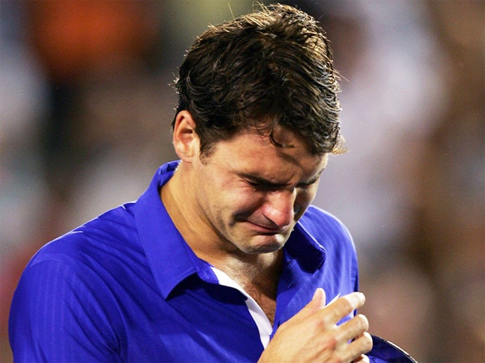 """<b>2009</b>: In his 18th Grand Slam final at the Australian Open, Federer was defeated by long-time rival Nadal in their first meeting on a hard court in a Grand Slam tournament. The match lasted over four hours with Nadal victorious in five sets. Federer broke down in tears during the trophy presentation and struggled to make his runner-up speech.<br><br> He, however, won his maiden French Open, beating Robin Söderling in the final 6–1, 7–6(1), 6–4. With the win, Federer equaled Pete Sampras's men's record of 14 Grand Slam titles and Ivan Lendl's record of 19 Grand Slam finals, and also became the sixth man in history to complete a Career Grand Slam. At the Wimbledon finals that took 4 hours and 17 minutes to complete, he beat Roddick in the latest chapter of their long, though lopsided rivalry, regaining the World No. 1 spot from Rafael Nadal. The match was also the longest men's singles final (in terms of games played) in Grand Slam history with 77 games played, and the fifth set alone lasted 95 minutes. The match has been called an """"instant classic"""" by ESPN. With the win, he also became the fourth man in the open era to win both the French Open and Wimbledon in the same year.<br><br> At the US Open he lost to Juan Martin del Potro in the final, the score being 6–3, 6–7(5), 6–4, 6–7(4), 2–6. The loss broke Federer's streak of forty consecutive wins at the US Open. It also marked the first time Federer had lost in a Grand Slam final to an opponent other than Rafael Nadal. 2009 was a year when Federer managed to accomplish three major goals: winning his first French Open title, breaking Pete Sampras's record of 14 Grand Slam wins and regaining the Number 1 ranking from Rafael Nadal."""