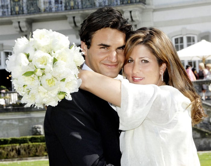 Federer is married to former Women's Tennis Association player Mirka Vavrinec. They met while competing for Switzerland in the 2000 Sydney Olympics. Vavrinec retired from the tour in 2002 because of a foot injury and has since been working as Federer's public relations manager. They were married in Basel on 11 April 2009, surrounded by a small group of close friends and family at Wenkenhof Villa. According to Swiss newspaper <i>Blick</i>, Roger wore a Tom Ford suit, Mirka wore an Oscar de la Renta dress to the wedding. (Wikipedia/Agencies) (Photo Courtesy: Schweizer Illustrierte)