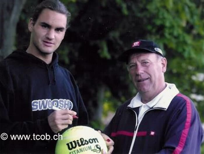 """When he was 10, Federer began weekly private coaching with Adolf Kacovsky – a tennis coach at The Old Boys Tennis Club. """"I noticed right away that this guy was a natural talent,"""" said Kacovsky. """"He was born with a racquet in his hand."""" At first, Federer received lessons only in a group, but """"the club and I quickly noticed he was enormously talented. We began giving him private lessons that were partly funded by the club. Roger was a quick learner. When you wanted to teach him something new, he was able to pick it up after three of four tries, while others in the group needed weeks.""""<br><br>A """"star pupil"""", the Swiss youngster always wanted to become the best in the world. """"People laughed at him, including me,"""" recollects Kacovsky. """"I thought that he would perhaps become the best player in Switzerland or Europe but not the best in the world. He had it in his head and he worked at it."""" In this picture Federer (2001) is seen with tennis coach Kacovsky. (Photo Courtesy: Tennis Club Old Boys Basel)(Wikipedia)"""