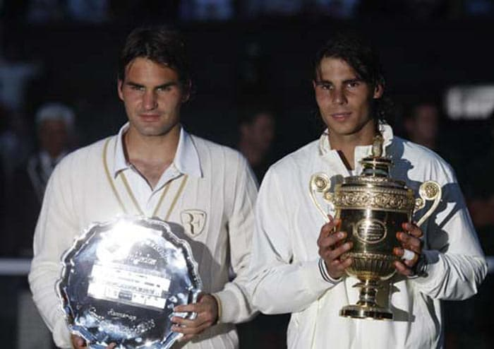 In 2008, at Wimbledon, Federer once again played hitherto World No. 2 Nadal in the final. A victory for Federer would have meant his sixth consecutive Wimbledon singles title, breaking Borg's modern era record and equaling the all-time record held since 1886 by William Renshaw. Federer saved two championship points in the fourth set tiebreak but eventually lost the match 6-4, 6-4, 6-7(5), 6-7(8), 9-7. The rain-delayed match ended in near darkness after 4 hours, 48 minutes of play, making it the longest (in terms of elapsed time) men's final in Wimbledon recorded history. It concluded 7 hours, 15 minutes after its scheduled start. (AFP Photo)
