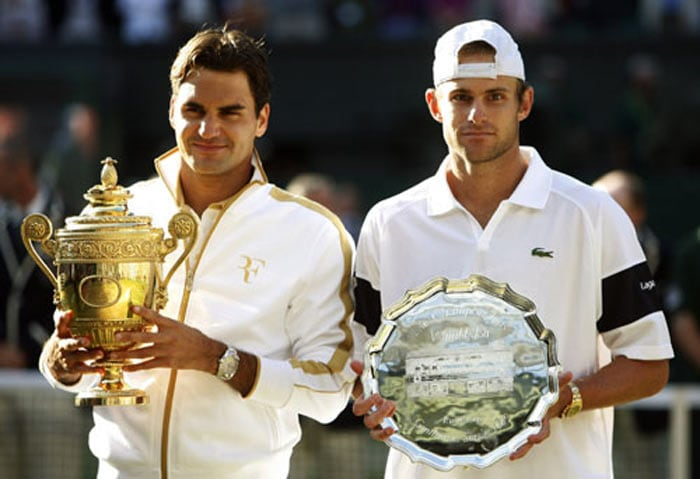 Roger Federer secured a record-breaking 15th grand slam after he finally overcame Andy Roddick in a tense and gruelling five-set men's singles final at Wimbledon. The Swiss player's sixth Wimbledon title takes his overall tally of grand slam wins to 15, putting him ahead of Pete Sampras, who was present on Centre Court to watch Federer's gruelling 5-7, 7-6, 7-6, 3-6, 16-14 victory in what became the longest ever men's singles final at the All England club. (AFP Photo)