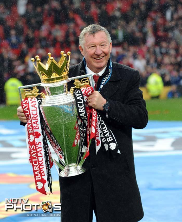 Ferguson was presented with the Premier League trophy, which United secured for an unprecedented 20th time three weeks ago, as the 13th title party of his Old Trafford tenure got underway.