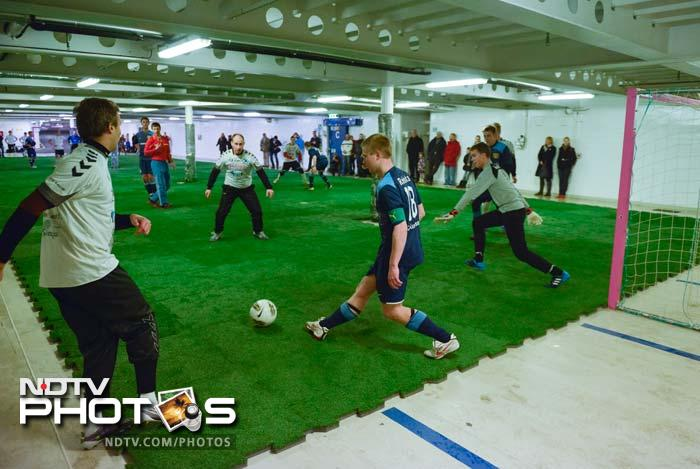 Footballers found a place to play their game even inside a ferry