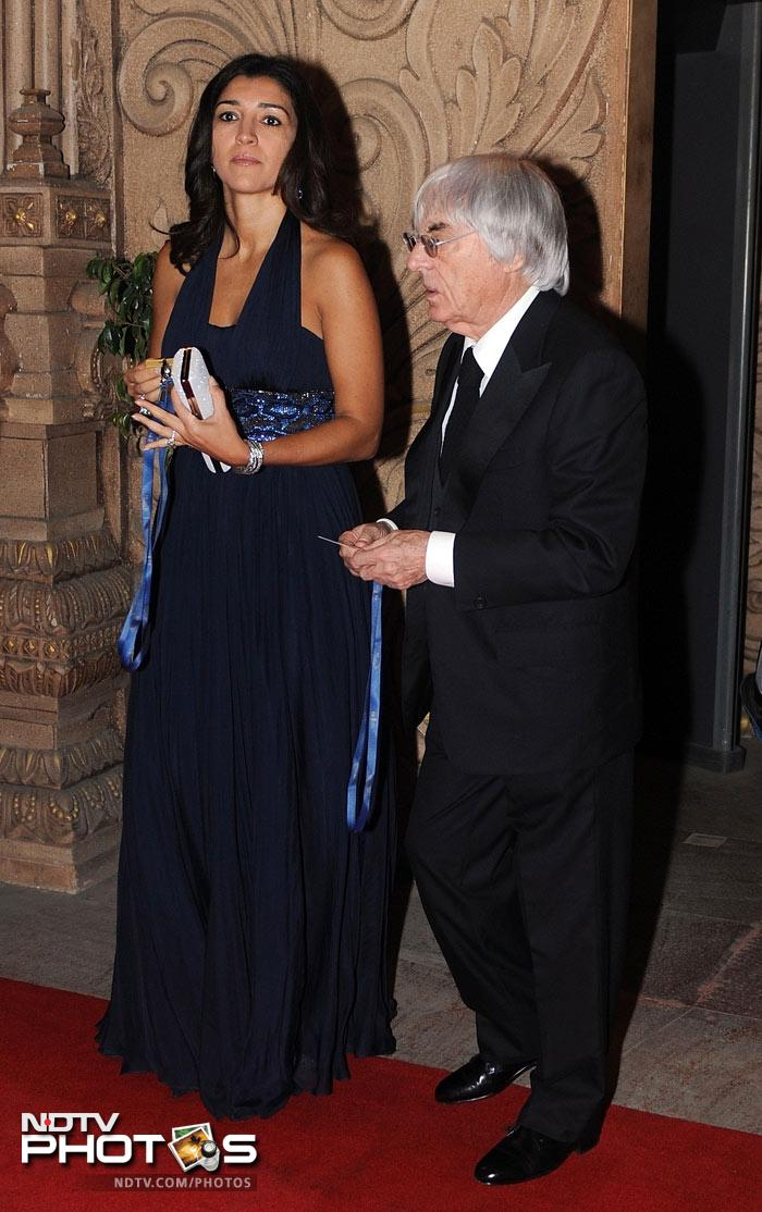 Bernie Ecclestone (R), chief executive officer and president of the Formula One's governing body, arrives for the 2011 FIA Gala.