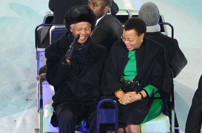 South Africa former President Nelson Mandela and his wife Graca Machel arrive for the 2010 FIFA football World Cup final. (AFP Photo)