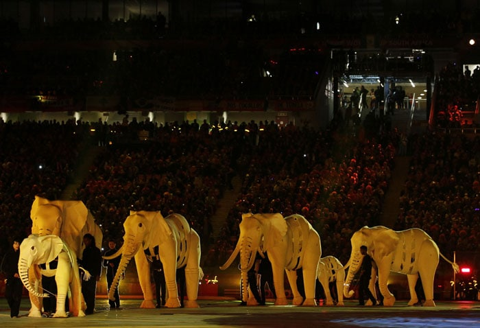 The ceremony oozed with the African flavour. Puppets representing elephants were walked onto the stage by the performers. (AFP Photo)