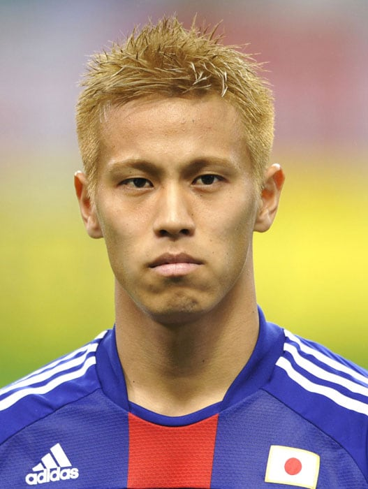 """With dyed blonde hair, a self-avowed """"big mouth"""" and a hunger for scoring goals, CSKA Moscow rookie Keisuke Honda is the rising star in Asia's World Cup contingent.<br/><br/> He has emerged from the shadow of former Celtic man Shunsuke Nakamura in Japan but still has some way to go before matching South Korea and Manchester United winger Park Ji-Sung as the continent's brightest talent.(AFP PHOTO)"""