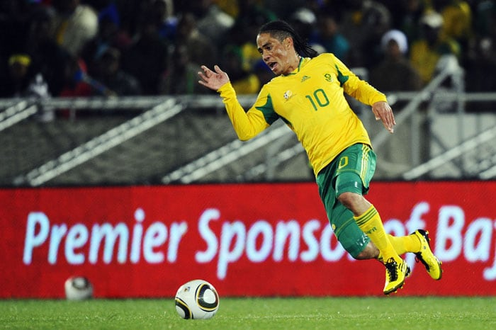 South Africa football talisman Steven Pienaar has come a long way since cowering on the floor of his childhood home to ensure he was not hit by a stray bullet. <br/><br/> He was voted Everton Player of the Year last week, testimony to accurate passing and a high work rate that triggered media speculation of a move to champions Chelsea, Manchester United, Arsenal or Tottenham Hotspur.<br/><br/> And after a short end-of-season break to recharge batteries drained by a punishing English season, Pienaar will join his international team-mates and Brazilian coach Carlos Alberto Parreira at their Johannesburg base.(AFP PHOTO)