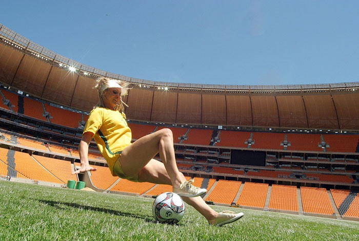 Miss Australia falls as she plays with the ball at Soccer city stadium during a visit by the 112 Miss World contestants on December 6, 2009 in Johannesburg as part of their month-long South African festival before the crowning of the new Miss World. Soccer City is one of the ten venues of the World Cup to be held in in June and July of 2010 in locations throughout South Africa. (AFP Photo)