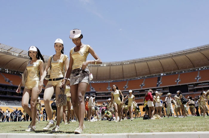 Contestants in the Miss World Pageant visit Soccer City stadium in Johannesburg. From left are Miss Vietnam Tran Thi Huong Giang, Miss Thailand Pongchanok Kanklab and Miss Zimbabwe Vanessa Sibanda. (AP Photo)