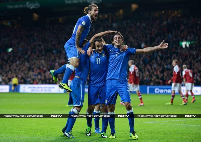 Denmark's hopes of a World Cup revival suffered a blow on Friday after a late equaliser by Alberto Aquilani helped Italy secure a 2-2 draw that maintained their unbeaten record in Group B.