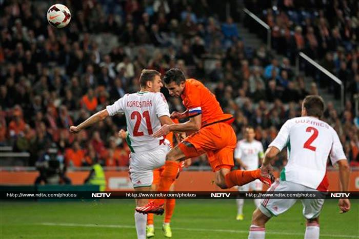 Robin van Persie scored a hat-trick on Friday to become the all-time Dutch top scorer as the Netherlands thrashed Hungary 8-1 in a World Cup qualifier. The Netherlands had already qualified for next year's finals, and Hungary's hopes of consolidating second place in Group D were erased by a vintage Dutch performance.