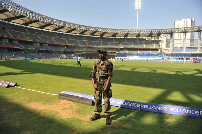 An Indian soldier stands guard during a training session of the Sri Lankan cricket team at The Wankhede Cricket Stadium. (AFP Photo)