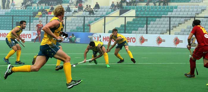 Australia edged past Belgium, beating them 3-2 to open their account with a win in the pool B tie.