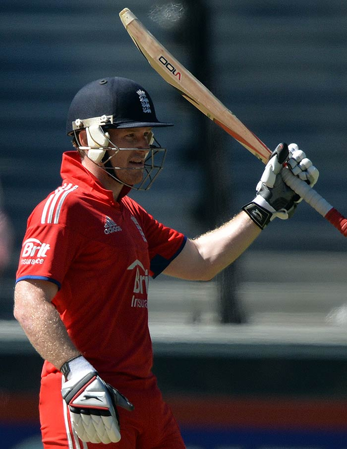 From 62 for three, Eoin Morgan hit a whirlwind fifty to guide England to respectability.