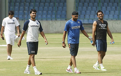 Indian players Suresh Raina, Rudra Pratap, Singh Harbhajan Singh and Mahendra Singh Dhoni walk off the field after a fitness test session in New Delhi. (AP Photo)