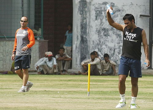 Gary Kirsten looks on as Mahendra Singh Dhoni leaves after a fitness test session in New Delhi. (AP Photo)
