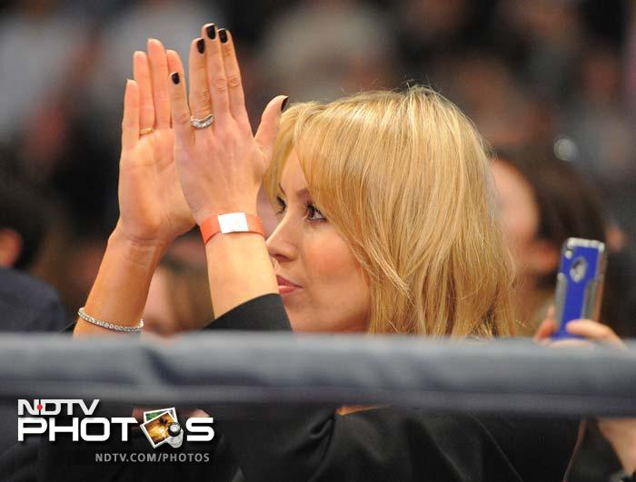 Rachel Flintoff, wife of Former England cricketer turned professional boxer Andrew Flintoff, applauds as he fights US boxer Richard Dawson in their heavyweight boxing bout at the Manchester Arena in Manchester.