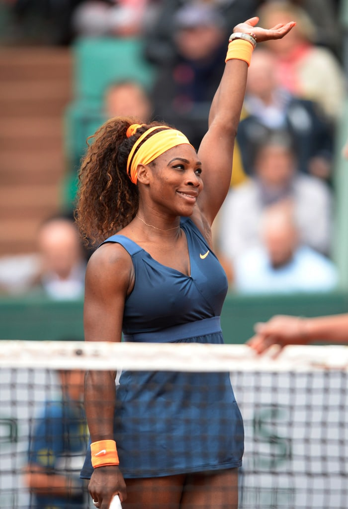Serena Williams coasted into the last 16 of the French Open on Friday with a 6-0, 6-2 win over Sorana Cirstea of Romania.