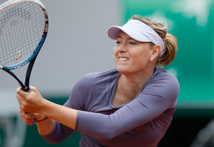 Defending champion Maria Sharapova of Russia reached the third round of the French Open on Friday with a 6-2, 6-4 win over Eugenie Bouchard of Canada.