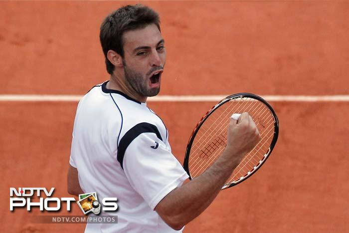 Marcel Granollers of Spain battles hard in his third round match against Paul-Henri Mathieu of France before winning 6-4, 6-4, 1-6, 4-6, 6-1.