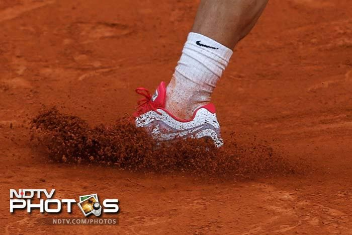Day 7 of the French Open saw a grumpy Wozniacki, a sorry Youzhny, a trimphant Nadal and more. A look at the highlights....(All AFP and AP Images)