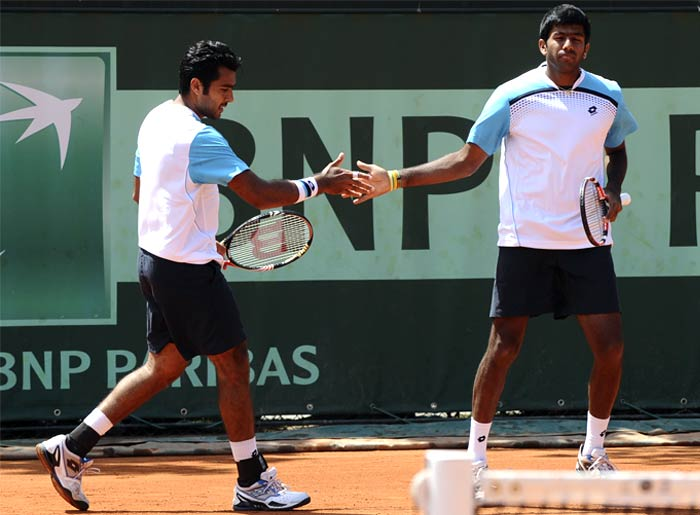India's Rohan Bopanna along with his Pakistani partner Aisam-ul-haq Qureshi defeated Japan's Kei Nishikori and Argentina's Maximo Gonzalez in the men's double second round match. (AFP Photo)