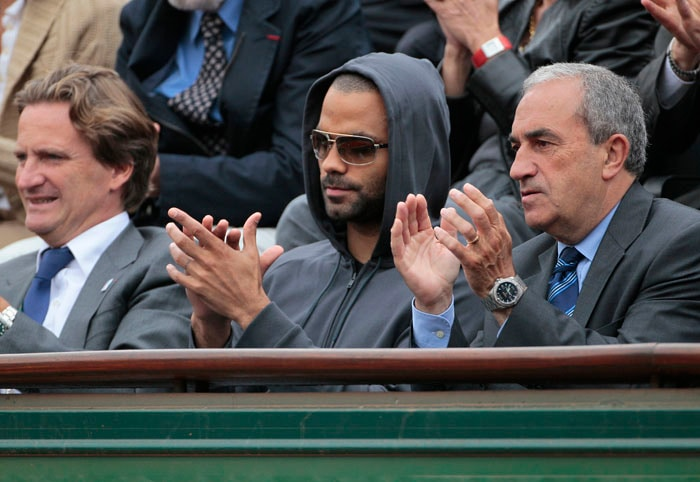 French businessman Charles Beigbeder, French basketball player Tony Parker (C) and President of French Tennis Federation Jean Gachassin attended the match between Switzerland's Stanislas Wawrinka and France's Jo-Wilfried Tsonga. (AFP PHOTO)