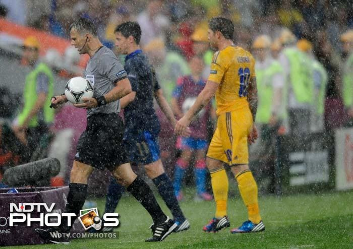 Dutch referee Bjorn Kuipers ordered both teams off after just five minutes, as violent thunder and electric storms lashed Shakhtar Donetsk's Donbass Arena, flooding parts of the playing surface.