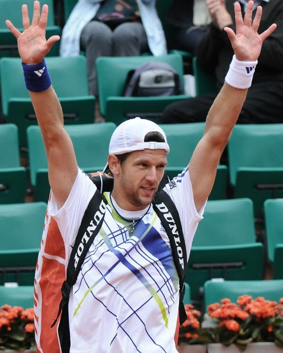 Austria's Jurgen Melzer reacts after he defeated Russia's Teimuraz Gabashvili at the end of their fourth round match in the French Open tennis championship at the Roland Garros stadium, in Paris. Melzer won 7-6, 4-6, 6-1, 6-4. (AFP Photo)