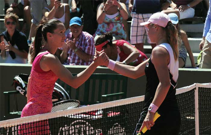Jelena Jankovic of Serbia shakes hand with her Russian opponent Vera Dushevina after beating her in straight sets.