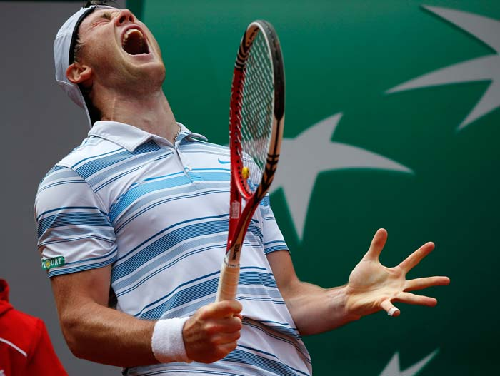 Ukraine's Illya Marchenko reacts after a point against South Africa's Kevin Anderson.<br><Br>This is just an example of how much every single point means to a player. (AFP image)