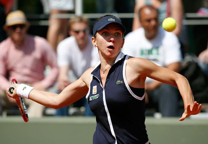 Romania's Simona Halep has her eyes only for the ball as she prepares to hit a massive forehand. (AFP image)