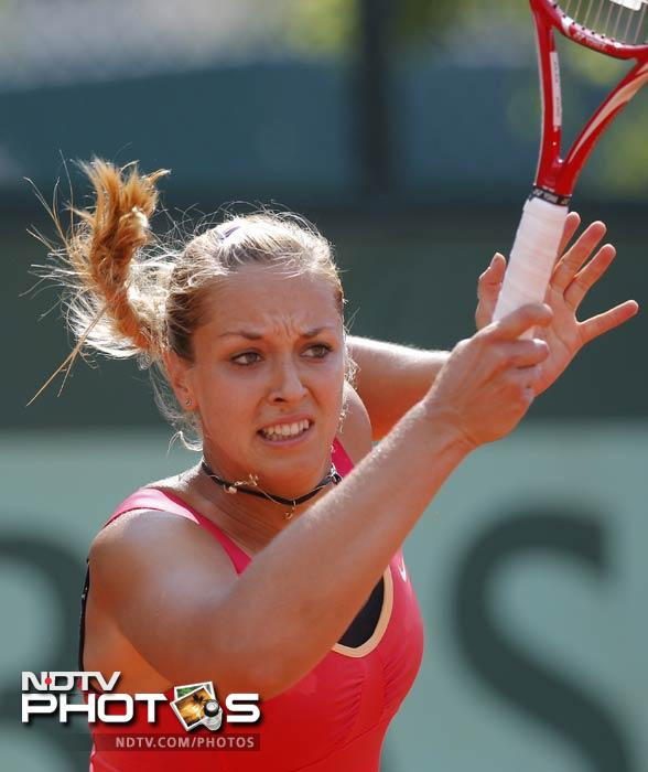 Germany's Sabine Lisicki returns the ball to USA's Bethanie Mattek-Sands during their first round match in the French Open at the Roland Garros stadium in Paris. (AP Photo)