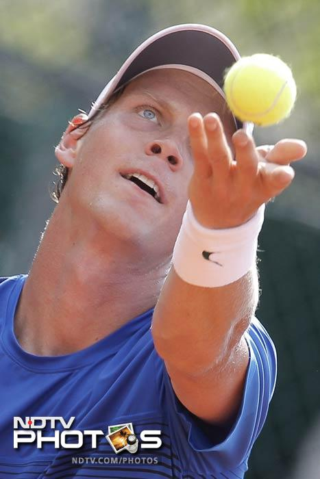 Tomas Berdych of the Czech Republic serves in his first round match against Dudi Sela of Israel at the French Open in Roland Garros stadium in Paris. (AP Photo)