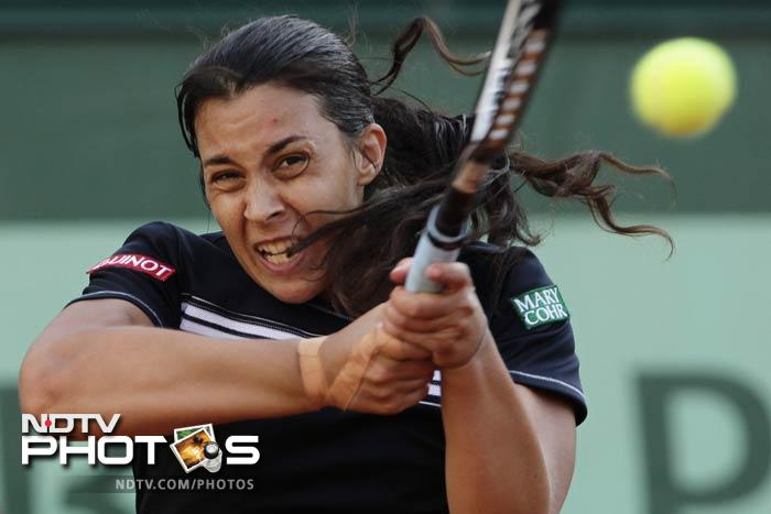 Marion Bartoli of France returns in her first round match against Karolina Pliskova of the Czech Republic at the French Open in Roland Garros stadium in Paris. (AP Photo)