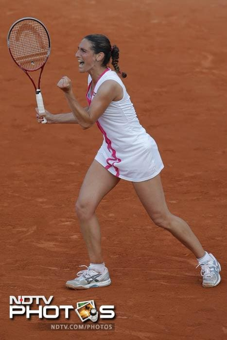 Virginie Razzano of France celebrates defeating Serena Williams of the U.S. after the ball went out in the first round match at the French Open in Roland Garros stadium in Paris. Razzano won in three sets, 6-4, 6-7. 3-6. (AP Photo)