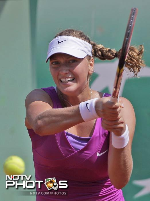 Czech Republic's Petra Kvitova returns the ball to Australia's Ashleigh Barty during their first round match in the French Open at the Roland Garros stadium in Paris. (AP Photo)