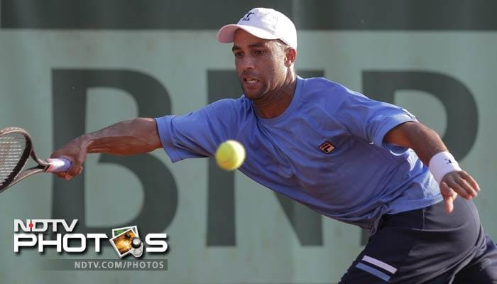 James Blake of the US returns in his first round match against Mikhail Youzhny of Russia at the French Open in Roland Garros stadium in Paris. (AP Photo)
