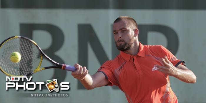 Mikhail Youzhny of Russia returns in his first round match against James Blake of the U.S. at the French Open in Roland Garros stadium in Paris. (AP Photo)