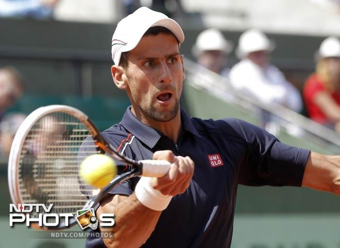 Serbia's Novak Djokovic returns the ball to Slovenia's Blaz Kavcic during their second round match in the French Open at the Roland Garros stadium in Paris. (AP Photo)