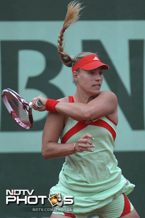 Angelique Kerber of Germany returns in her second round match against Olga Govortsova of Belarus at the French Open in Roland Garros stadium in Paris. (AP Photo)