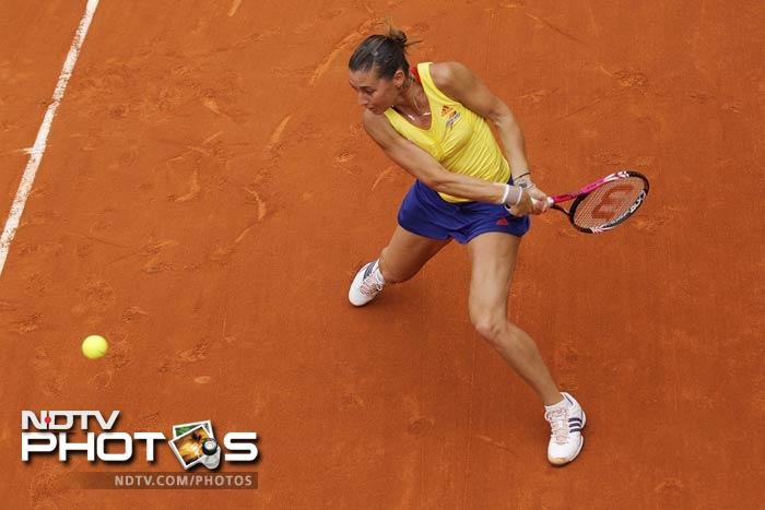 Flavia Pennetta of Italy returns in her second round match against Alexa Glatch of the US at the French Open in Roland Garros stadium in Paris. (AP Photo)