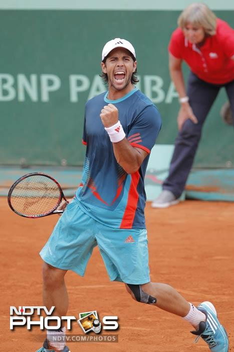 Fernando Verdasco of Spain celebrates winning his second round match against Giles Muller of Luxembourg at the French Open in Roland Garros stadium in Paris. (AP Photo)